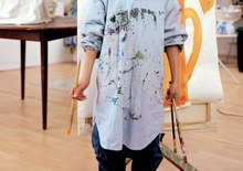 Boy wearing shirt stained with paint