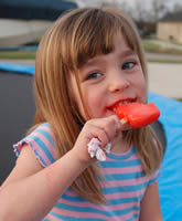 Girl holding a red popsicle