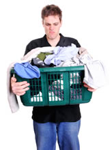 A man frustrated with doing the laundry